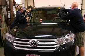Photo of Windshield Being Replaced on Toyota Car by Man & Woman